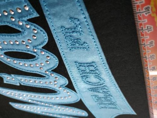 GRAFICOM Patch termoadesiva in tessuto cucito con borchie.